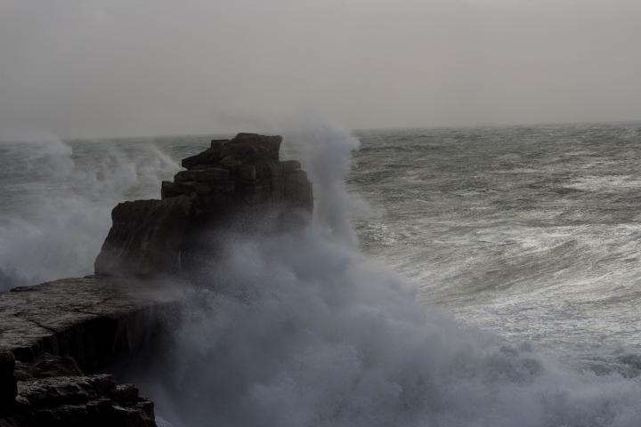 Pulpit Rock, being battered, Portland Dorset